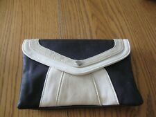 clutch purse with shoulder strap, card holders and inside pocket