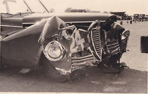 CAMPRARIS ALFA ROMEO, CAR No.24, AFTER CRASHING IN PRACTICE PHOTO, FRONT VIEW.