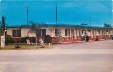St Petersburg FL Man Relaxes on Lawn Chair Outside Bamboo Motel on Haines Rd