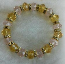 Amber and pale pink glass bead stretch bracelet