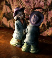 Two vintage porcelain figurines - small boys in hats