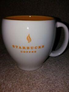 Starbucks 2004 White Mug with Yellow Interior.