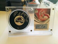 Patrick Roy autographs insert card and Signed puck with holder and COA
