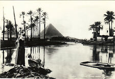 Rppc Men near Nile at Flood time Pyramids in background Cairo