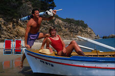 669005 Couple With Boat On Beach Greece A4 Photo Print