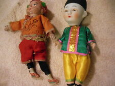 2 Oriental bisque dolls