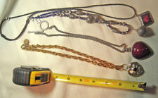Four pendant style necklaces: includes vatican and others