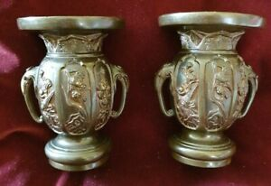 PAIR OF JAPANESE PATINATED BRONZE VASES, with elephant head handles 14cm high
