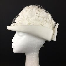 A Barnetat Hat White with White Flowers and Netting. Bow At Back.