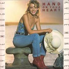DISCO 45 GIRI   KYLIE MINOGUE - HAND ON YOUR HEART / JUST WANNA LOVE YOU