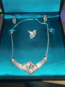 Absolutely gorgeous natural diamond and rhodium plated sets