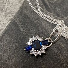 18CT WHITE GOLD DIAMOND AND BLUE SAPPHIRE PENDANT ON SILVER CHAIN