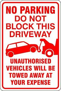 No Parking Unauthorised Vehicles will be Towed Away
