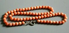 VINTAGE NATURAL CORAL NECKLACE WITH STERLING SILVER CLASP. UNIFORM BEADS.