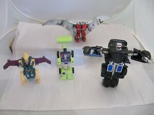 4 1980's Transformers from Bandai, Hasbro and Takara.