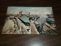 1909 NEW HAVEN RAILROAD PASSENGER TRAIN AT BRIDGEPORT, CT STATION USED POSTCARD