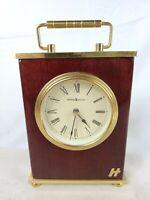 Howard Miller 613-528 Glossed Wood and Metal Bracket Table Quartz Clock