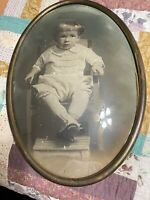 "Antique Baby Portrait in oval brass frame & convex bubble Glass 20"" x 14"""