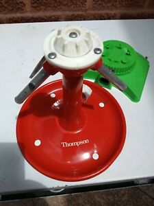 VINTAGE THOMPSON ROTATING SPRINKLER, AND UNKNOWN PLASTIC DIAL SPR. EXC.