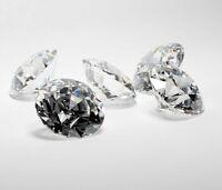 2 diamants blancs naturels ( 0.06 cts - VS - J )