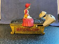 Bits and Pieces Cast Iron Red Riding Hood and Wolf Mechanical Bank