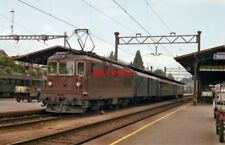PHOTO  BLS RE4/4 BO-BOS NO. 177 STANDS AT SPIEZ WITH A TRAIN FOR BRIG