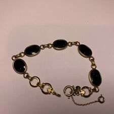 "Gold filled bracelet with 5 black onyx stones 7"" signed AMCO"