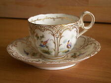 MID 19TH CENTURY COALPORT CUP AND SAUCER PAINTED WITH BIRDS