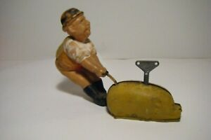 VTG 1930'S CELLULOID MADE IN JAPAN MAN W/PIG WIND-UP TOY