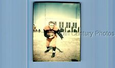 Found Color Photo K+0585 Teen Boy In Football Uniform Leaned Over Holding Ball