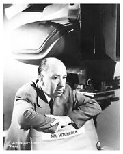 ALFRED HITCHCOCK on set of VERTIGO with large camera in background - (g239)