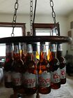 """Beer Bottle Chandelier. 18"""" stained wood,3' chains,16 bottles and 15' plug in"""