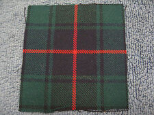 48th Highlanders cap badge tartan backing