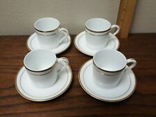 Lot of 4 Demitasse Cup & saucer sets.  White gold trim china