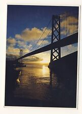 Old Postcard (1988) - The Oakland Bay Bridge Silhoutted by The Ea - Posted 0273