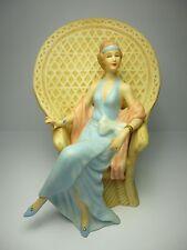 VINTAGE Elegant Lady  Figurine Sitting In A  Tan Rattan Chair