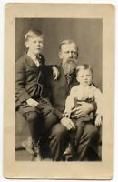 011021 VINTAGE RPPC REAL PHOTO POSTCARD GRANDPA WITH TWO GRANDSONS PAPA CARL ROY