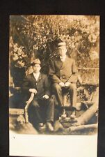 Real Photo, Divided Back Postcard - Two Males in Suits, Ties & Hats On Log Bench
