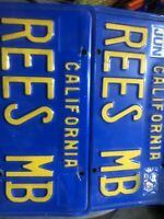 One Pair of california license plates blue and gold.