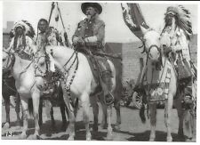 Buffalo Bill Cody on his white horse with Native Americans in full dress