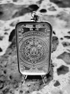 1 oz .999 silver aztec calendar bar wrapped in a   .925 sterling silver bezel
