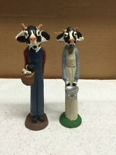 Pair Of Tall Skinny Cow Figurines