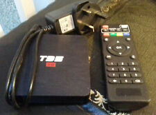 T95 S2 Android TV Box with power lead and remote.