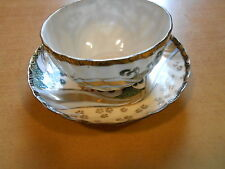 ASIAN CUP AND SAUCER, TRANSLUCENT, DRAGON MOTIF, LOTS OF GOLD DECORATION