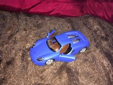KINSMART MATT 1/36 SCALE DIECAST BLUE PORSCHE CARERRA GT WITH OPENING DOORS