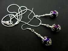 A PRETTY METALLIC PURPLE  BEAD NECKLACE AND  EARRING SET. NEW.