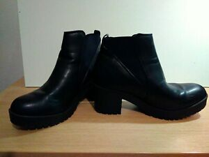 Woman's Faux Leather Black Ankle Boots Size 6 1/2.Heel 2 1/2 inches. Hardly worn
