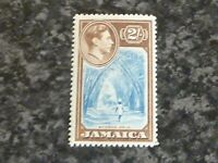 JAMAICA POSTAGE STAMP SG131 2/- BLUE & CHOCOLATE UN MOUNTED MINT