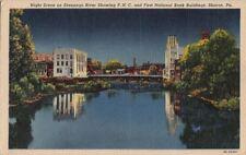 Postcard Night Scene Shenango River Showing PHC First National Bank Sharon PA