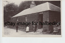 Rural family posed at cottage. North Northumberland area